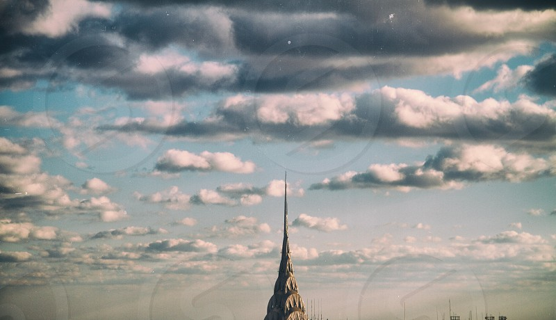 chrysler building with blue sky and clouds photo