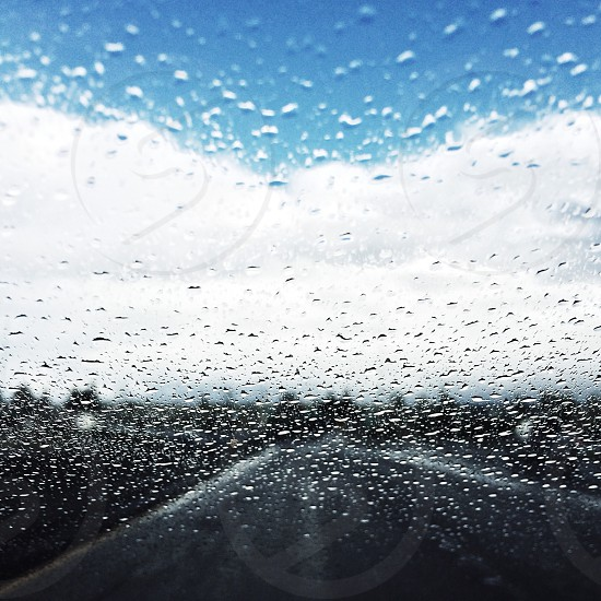 water droplets on car tempered windshield photo