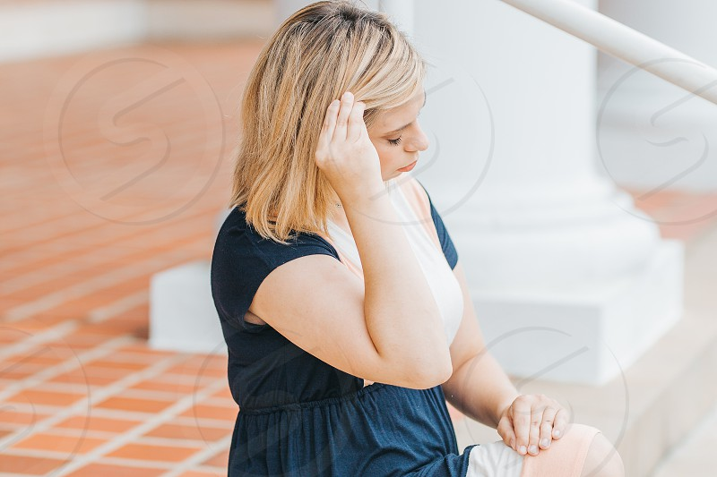 Young woman with Rheumatoid Arthritis in everyday life photo
