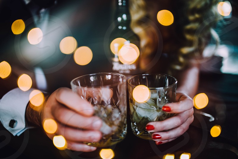 Celebration couple fun nightlife party alcohol drinks whiskey photo