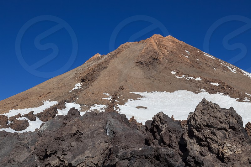 View of Mount Teide and it's surrounding lava fields photo