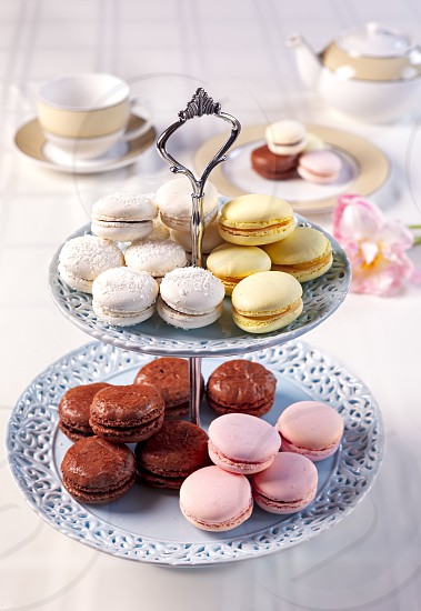 Variety of French Macarons on a Tiered Serving Dish photo