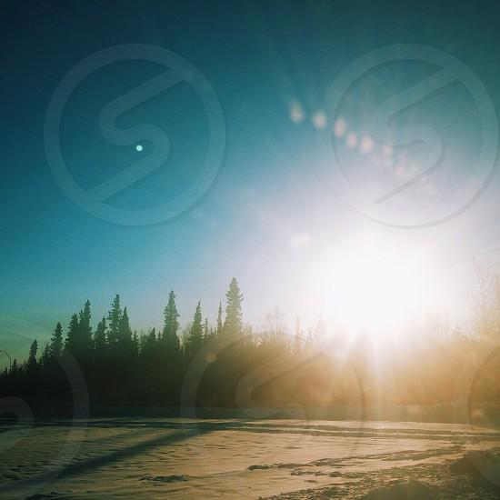 A winter scene during sunset in Alaska.  photo