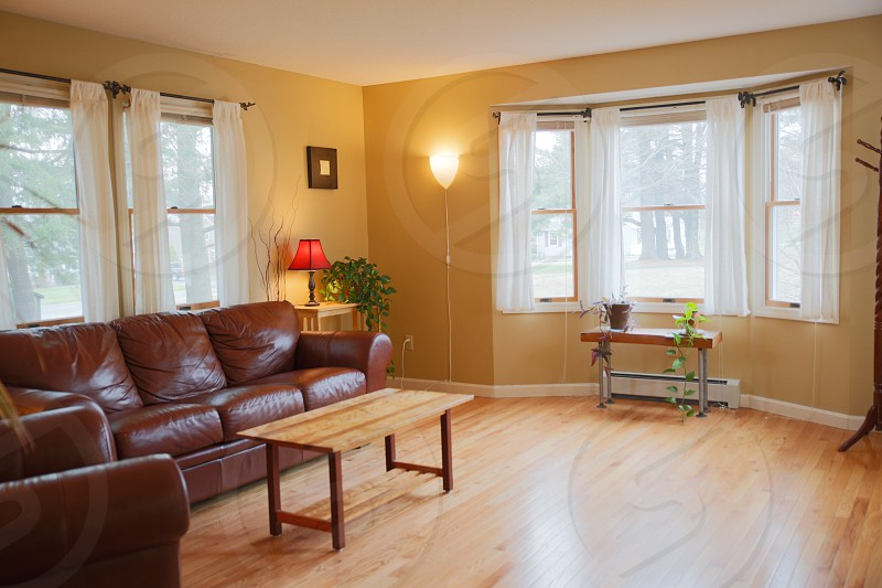 living room family room staged home house for sale home staging wood floors den house home leather couch photo