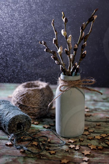 still life decorations vase willow drops wooden table photo