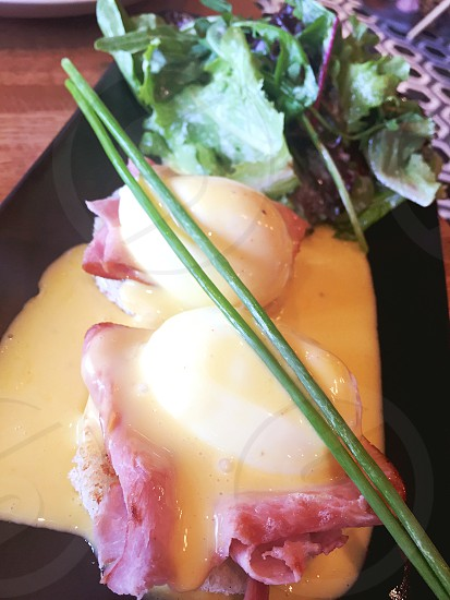 bacon and poach egg with green leaf vegetables photo