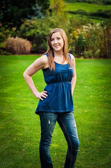 woman standing wearing blue tank top photo