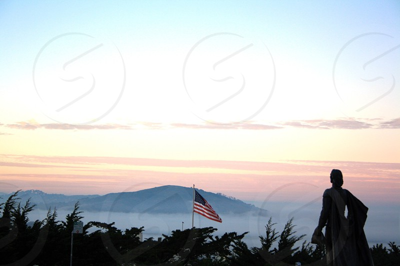 silhouette of person in front of USA flag at daytime photo