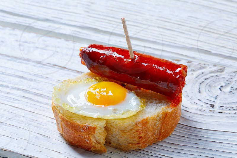 pinchos pintxos chistorra with quail egg tapas from Spain sausage food photo