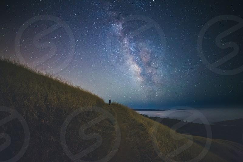 Milky Way galaxy universe stars cosmos planets night atmosphere alone photo
