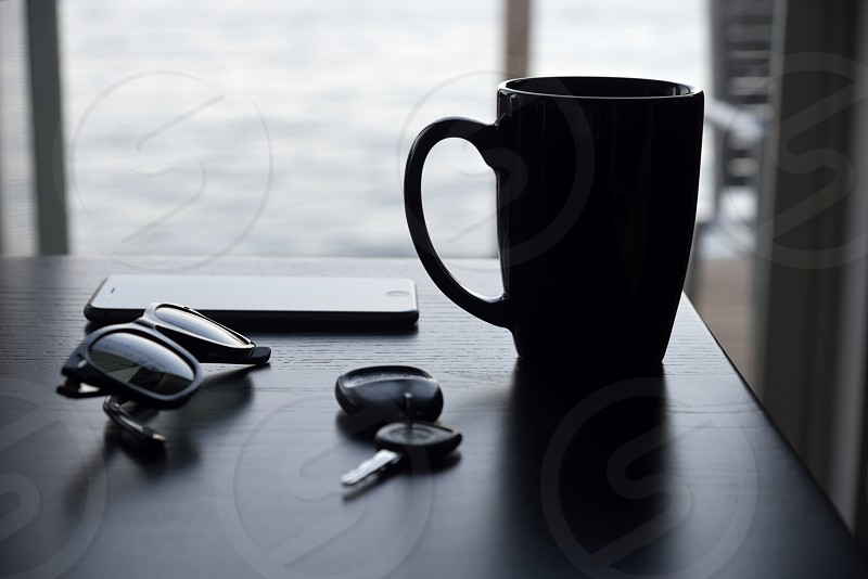 Morning supplies Coffee keys sunglasses phone light contrast shadows fob key car key mug morning early photo