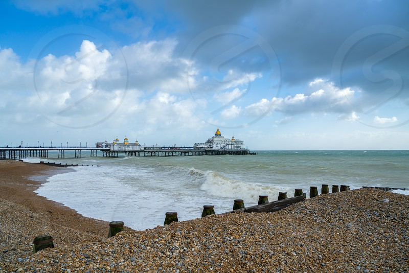 EASTBOURNE EAST SUSSEX/UK - OCTOBER 21 : Tail End of Storm Brian Racing Past Eastbourne Pier in East Sussex on October 21 2017 photo