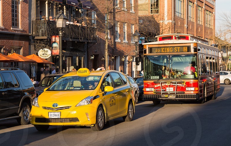 No property or model releases available - Editorial only. Yellow hybrid Toyota Prius taxi on King St in Old Town Alexandria in Virginia USA photo