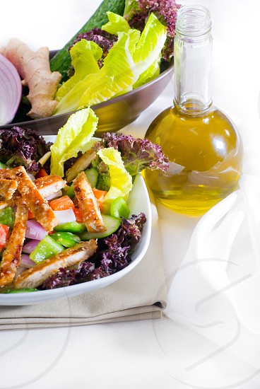 fresh colorfull sesame chicken salad close up photo