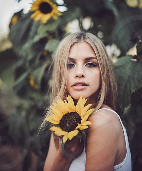 Blonde woman flower sunflower summer sun cute love smile plant green yellow  photo