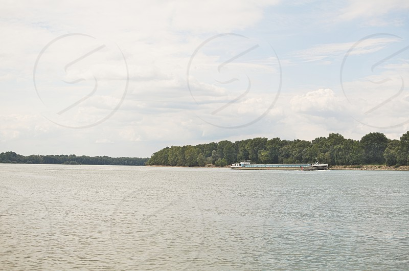 Long Barge on Danube River on a Summer Day photo