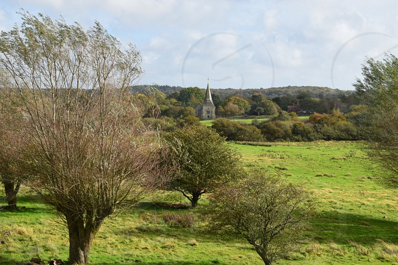 Church steeple cross countryside green grass beauty trees tranquil  photo