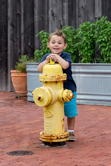 Spring fire hydrant yellow boy photo
