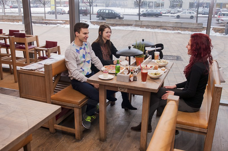 people eating drinking brunch scene bloody mary fun happy indoors restouran bar Vapiano tasty ad photo