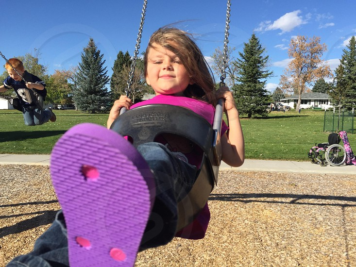Swings fun child playing sunny day photo