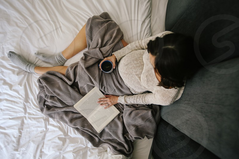 mother pregnant maternity belly mama in bed sleeping waking up tea book reading slow morning motherhood lifestyle love expecting expectant mother mom baby waiting morning read bed photo