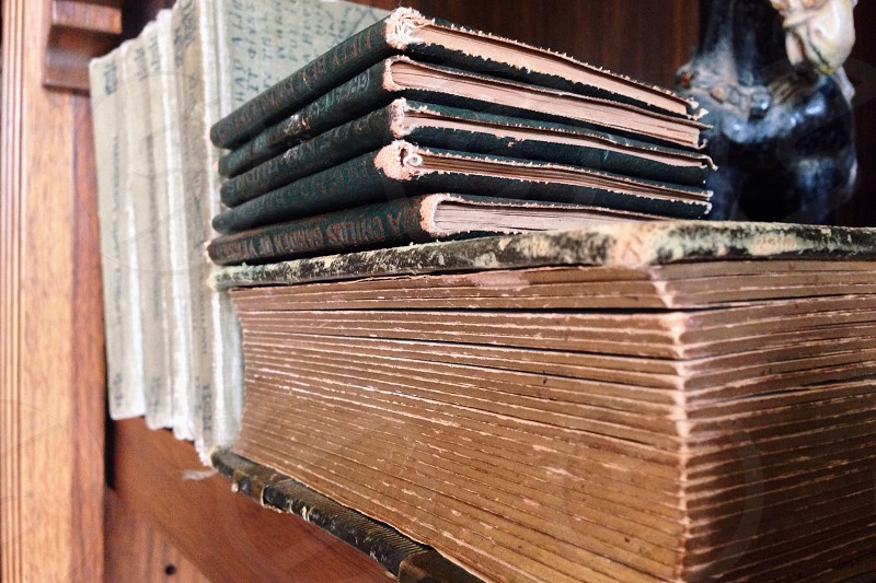 5 books arranged on brown wooden plank photo