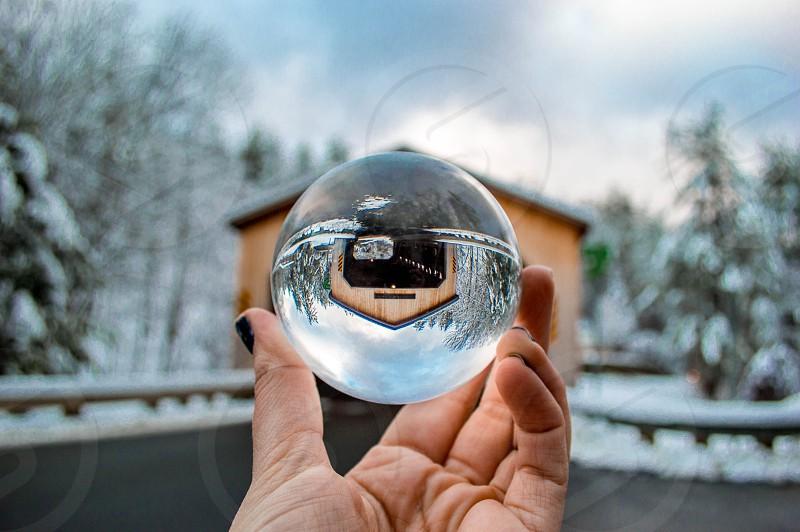 barn house upside down reflection on glass ball photo