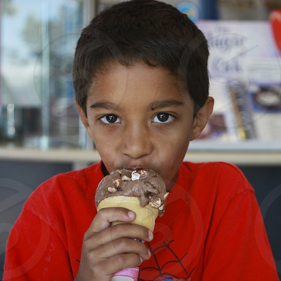 Child eating an ice cream cone photo