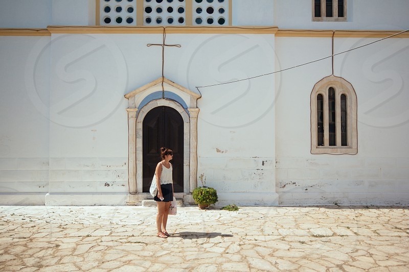 person in front of church photo