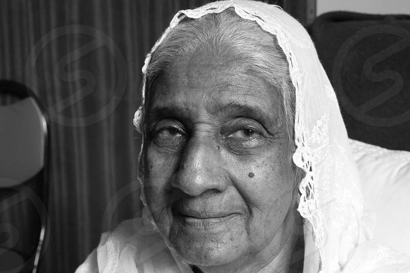 grandmother lady old person old woman monochromatic smiling veil white veil photo