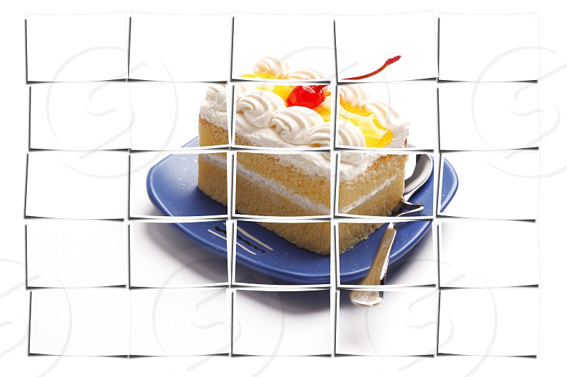 piece of lemon jelly cake with cherry on top on white background photo
