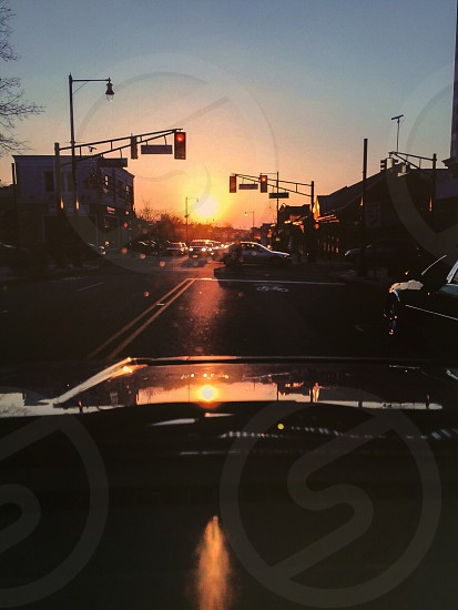 black vehicle on road at daytime photo