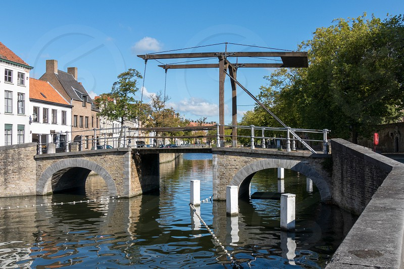 Bridge over a Canal in Bruges photo