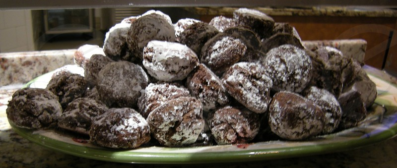 Pile of chocolate sugar-dusted cookies photo