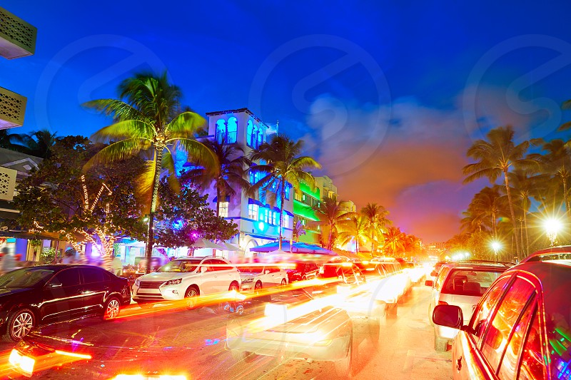 Miami Beach South Beach sunset in Ocean Drive Florida Art Deco and car lights photo