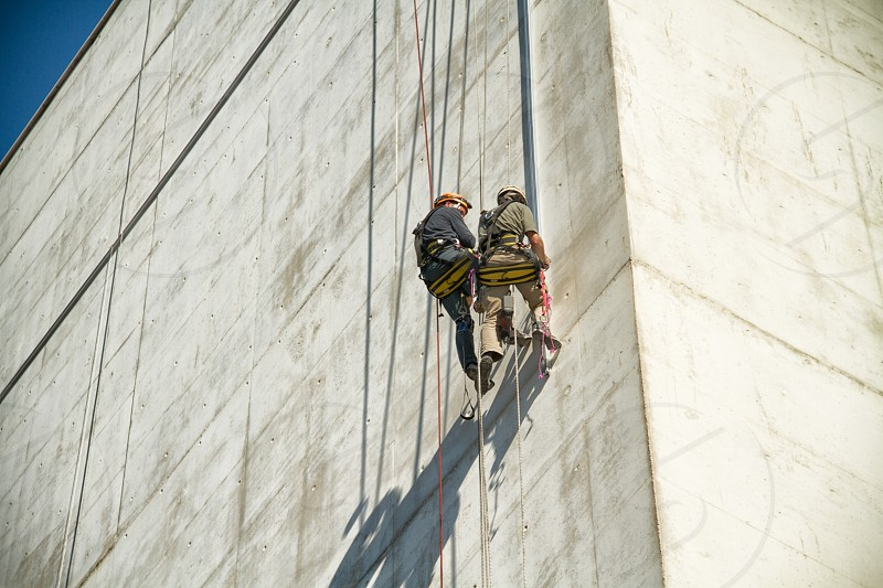 two people wall climbing photo