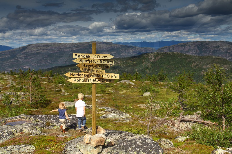 Hiking Mountains clouds sign photo