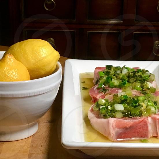 Lemons with marinading pork chops photo