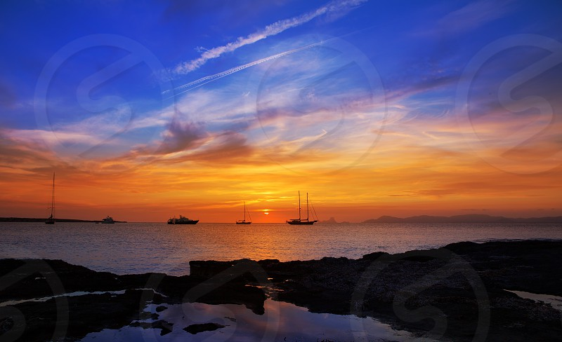 colorful sunset of Ibiza view from formentera with Es Vedra photo