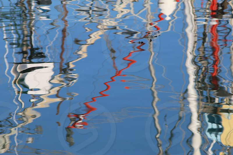 reflections on rippling water during daytime photo