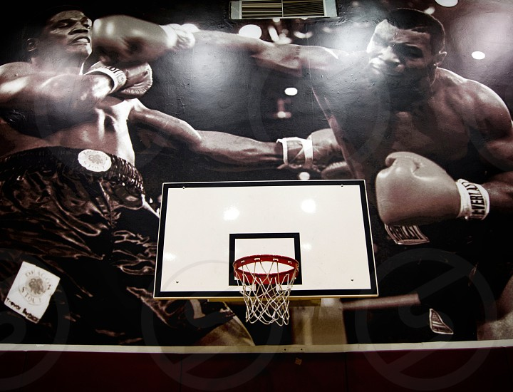 Basketball hoop and a wall poster. photo