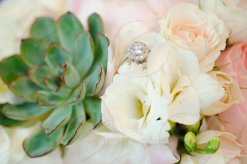 Wedding ring in flower bouquet photo