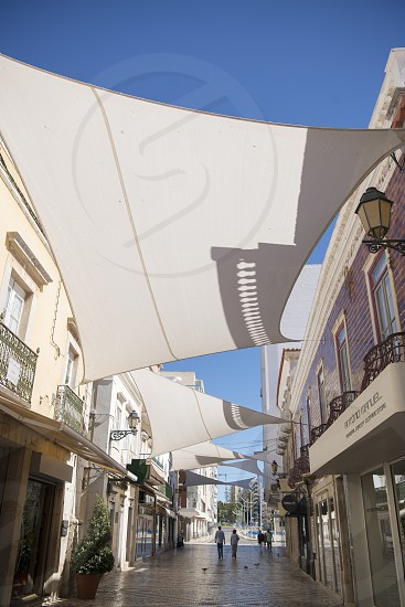 a street in the old town of Faro at the east Algarve in the south of Portugal in Europe. photo