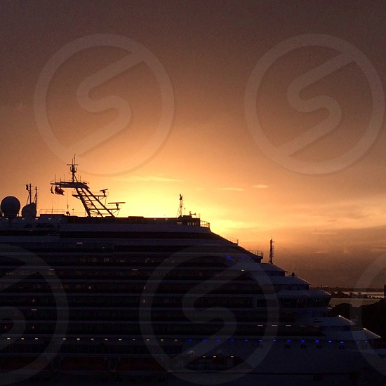 white cruise ship on sunset view photo