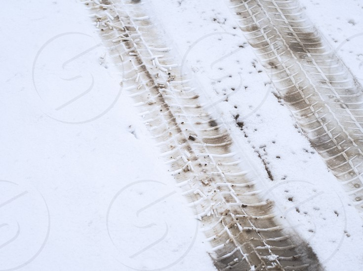Dirty Car Tracks in the Snow Closeup photo