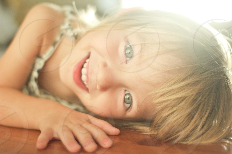 little girl with green eyes smiling  photo