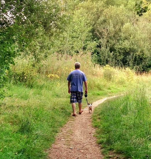 Walking the dog fresh air healthy living countryside  photo
