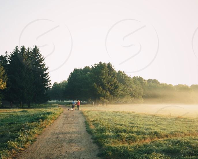 people walking on a dirt walkway photo