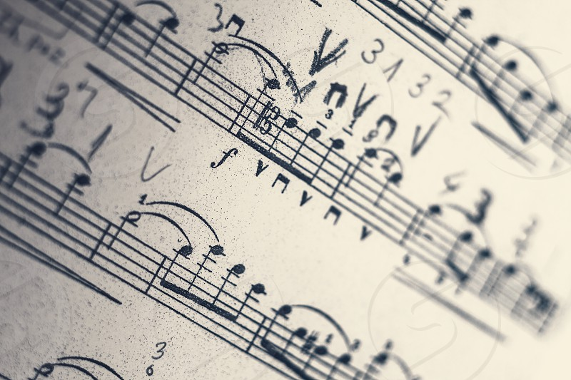 Closeup view of musical sheets a lot of notes and articulation symbols.  photo