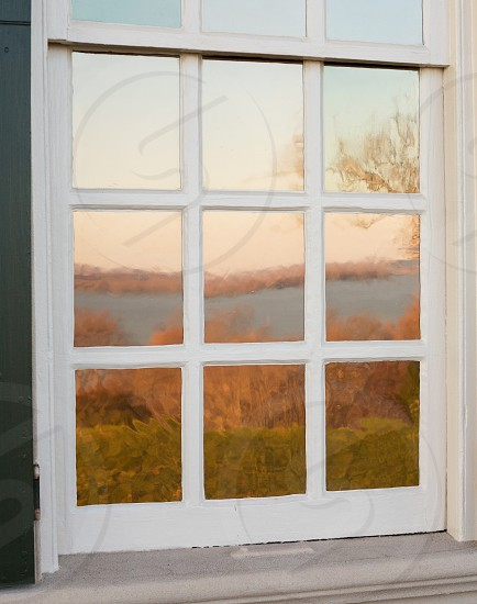 President George Washington home at Mount Vernon in Virginia with view of river reflected in glass windows photo